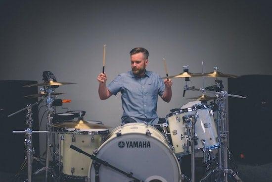 A drum teacher at their studio.