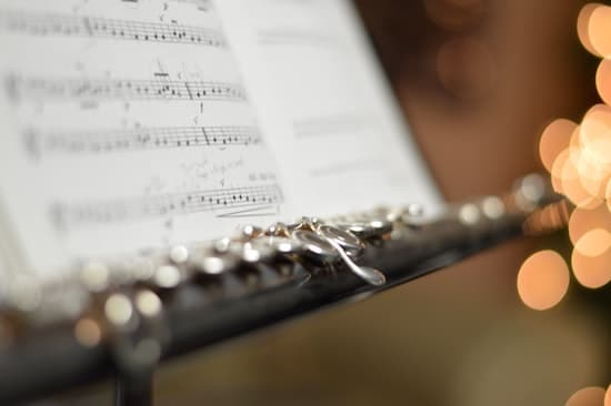 A flute and sheet music.