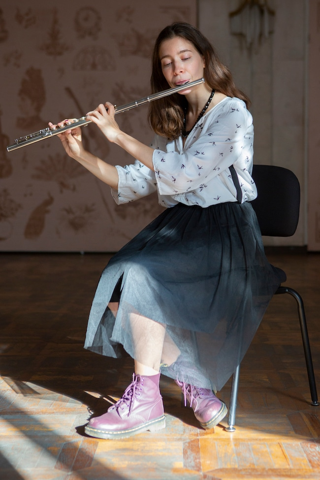 A flute student during a flute lesson.